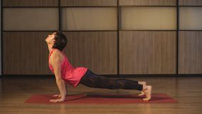Young woman training yoga - upward facing dog