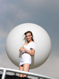 Young woman on trampoline with white balloon Royalty Free Stock Photos