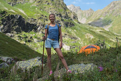 Young woman travel with backpack in mountain Stock Image