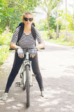 Young woman travel on bicycle. On country road Royalty Free Stock Images