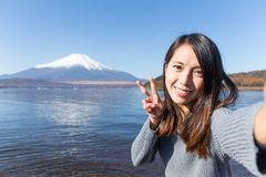 Young Woman travel in Fuji and taking selfie Stock Photo