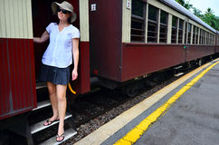 Young woman travel on old train Royalty Free Stock Photo