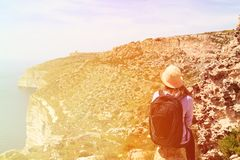 Young woman travel in summer mountains Stock Photos