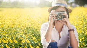 Young woman travel on vacation and using a camera to take photo Royalty Free Stock Photography