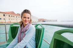 Young woman travel by venice water bus Royalty Free Stock Photo