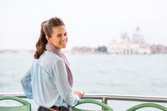 Young woman travel by venice water bus Royalty Free Stock Photos