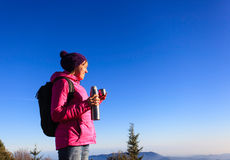 Young woman travel in winter mountains Royalty Free Stock Image