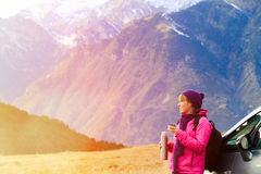 Young woman travel in winter mountains Stock Photography