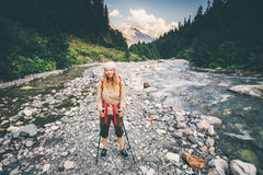 Young Woman Traveler with backpack crossing river royalty free stock photo