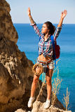 Young woman traveler hiking girl with backpack hiking in mountains Grand Canyon Crimea with beautiful summer sea landscape. Stock Photos