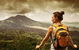 Young  Woman traveler looking at Batur volcano. Indonesia Royalty Free Stock Photos