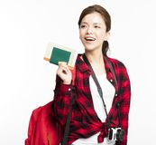 Woman traveler showing passport and ticket. Young Woman traveler showing passport and ticket Royalty Free Stock Images