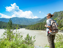 Young woman traveler standing in the beautiful mountain scenery. Stock Photography