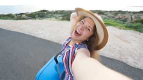 Young woman traveler taking selfie. Young woman taking selfie. Travel concept stock video footage