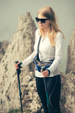Young Woman Traveler with trekking poles relaxing outdoor Royalty Free Stock Photo
