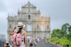 Asian hipster traveler looking to Ruins of St. Paul`s royalty free stock photography