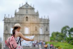 Asian hipster traveler looking to Ruins of St. Paul`s royalty free stock photos