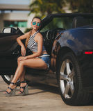 Young woman traveling by car the cities of America. Royalty Free Stock Photos