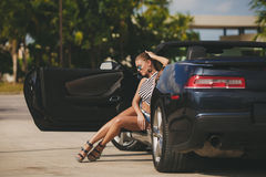 Young woman traveling by car the cities of America. Stock Images