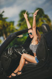 Young woman traveling by car the cities of America. Royalty Free Stock Photography