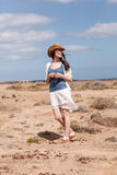 Young woman traveling in desert Stock Photos