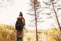 Young woman traveling in the forest. Side view royalty free stock image