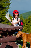 Young woman traveling with her dog Stock Image