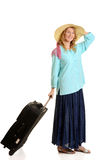 Young woman traveling with luggage Stock Photography