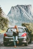Young Woman traveling by rental car roadtrip with map in Norway Travel Lifestyle Stock Images