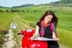 Young woman traveling by a scooter Stock Photo