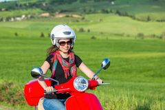 Young woman traveling by a scooter Stock Photography