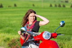 Young woman traveling by a scooter Stock Photos