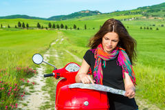 Young woman traveling by a scooter Royalty Free Stock Photos