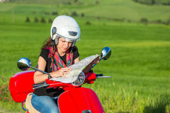 Young woman traveling by a scooter Royalty Free Stock Photo