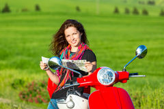 Young woman traveling by a scooter Royalty Free Stock Photography