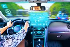 Young woman traveling in self driving car stock image