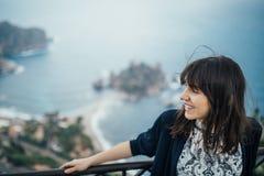 Young woman traveling to Italy.Visiting Taormina,Sicily,Italy.Woman traveler enjoying charming Mediterranean coastal city.Woman stock photos