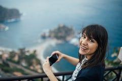 Young woman traveling to Italy.Visiting Taormina,Sicily,Italy.Woman traveler enjoying charming Mediterranean coastal city.Woman royalty free stock photo