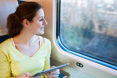 Young woman traveling by train Royalty Free Stock Images