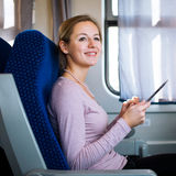 Young woman  traveling by train Royalty Free Stock Photography