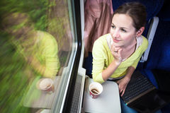 Young woman traveling by train Stock Images