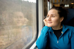 Young woman traveling by a train Stock Photography