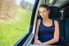 Young woman traveling by train Stock Image