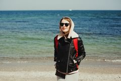 Young woman traveller on the seashore royalty free stock images