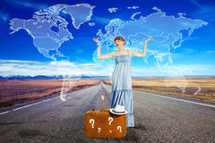 Young woman travelling  on the road with suitcase. Young beautiful woman travelling  on the road Royalty Free Stock Photo