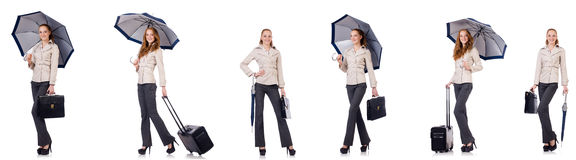 Young woman travelling with suitcase and umbrella isolated on wh Stock Photography