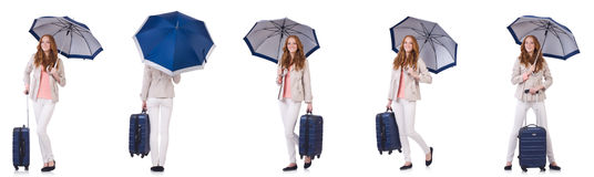 Young woman travelling with suitcase and umbrella isolated on wh Royalty Free Stock Photos
