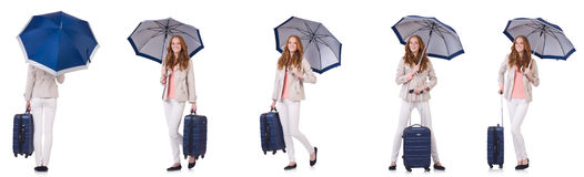 Young woman travelling with suitcase and umbrella isolated on wh Stock Photos