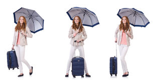 Young woman travelling with suitcase and umbrella isolated on wh Royalty Free Stock Images