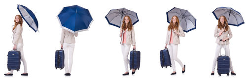 Young woman travelling with suitcase and umbrella isolated on wh Stock Images